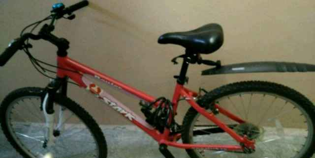 Женский велосипед stark розовый