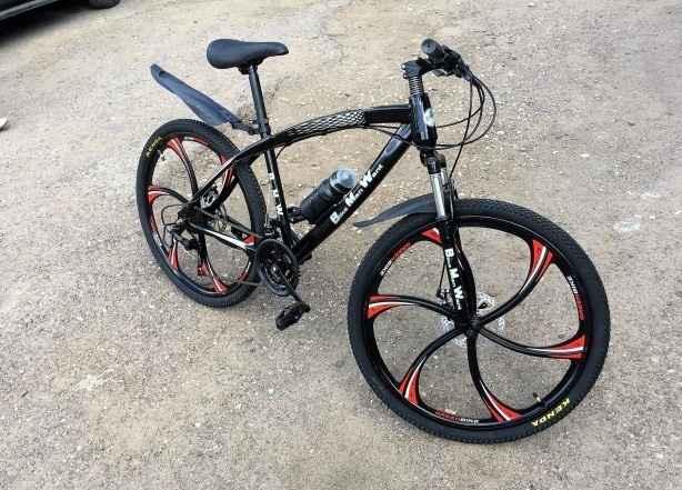 Велосипед Ягуар на литых дисках