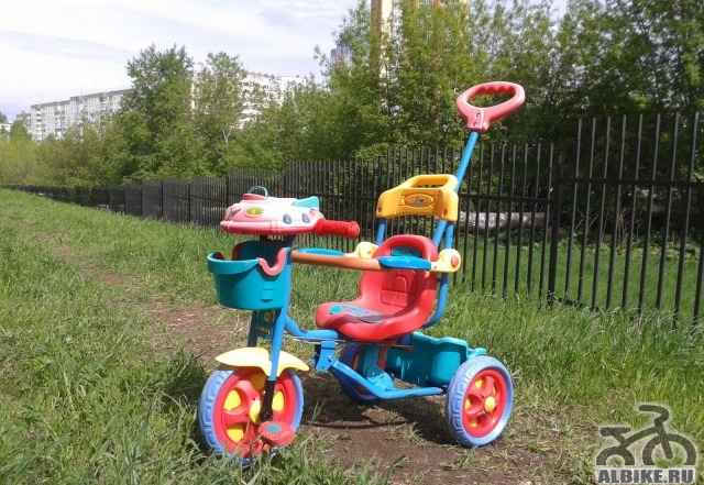 Велосипед-каталка трехколесный