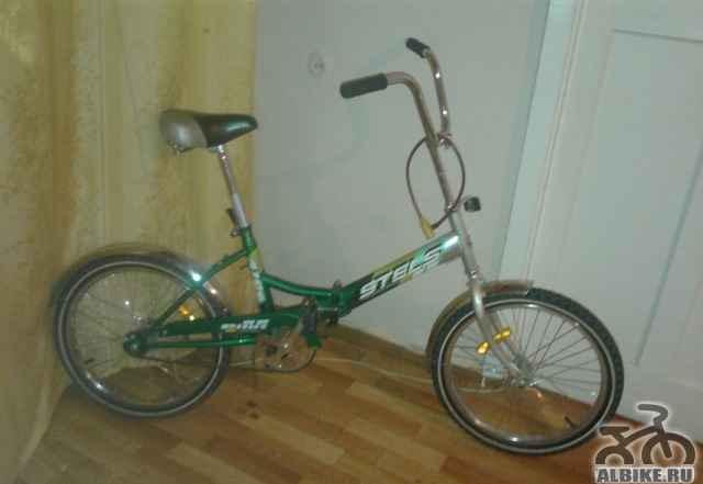 Продам складной велосипед Стелс пилот 410