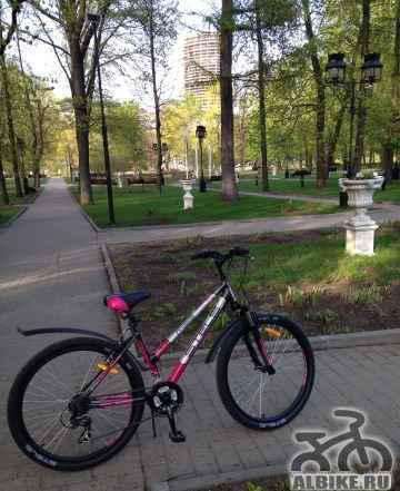 Стелс велосипед женский