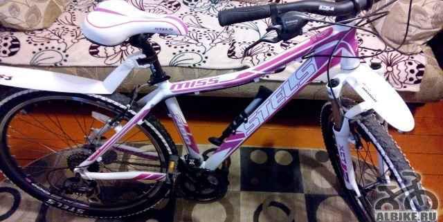 Велосипед стелс miss 7100 + насос и стойка под з/к