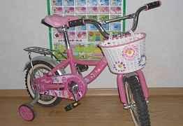 Детский розовый велосипед