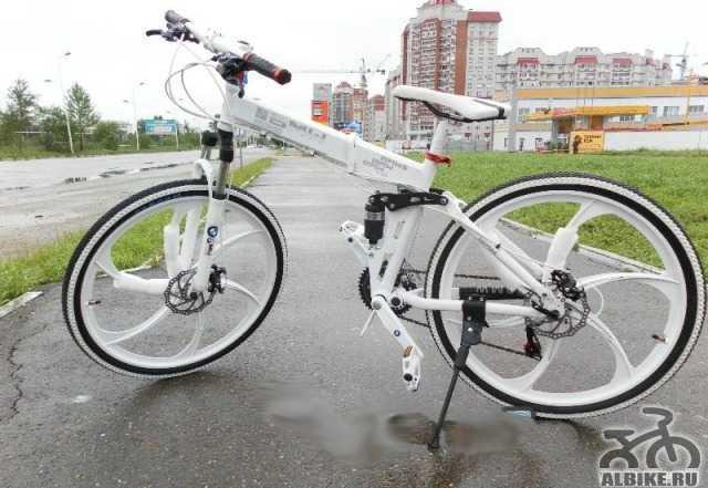 Велосипед на литых дисках БМВ x3 24 скорAltus Нали